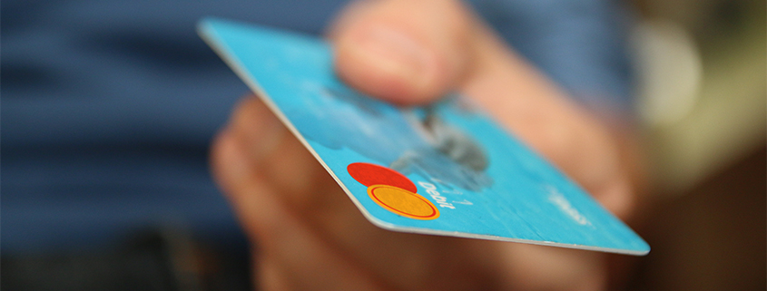 Man using FSA card to pay for LASIK