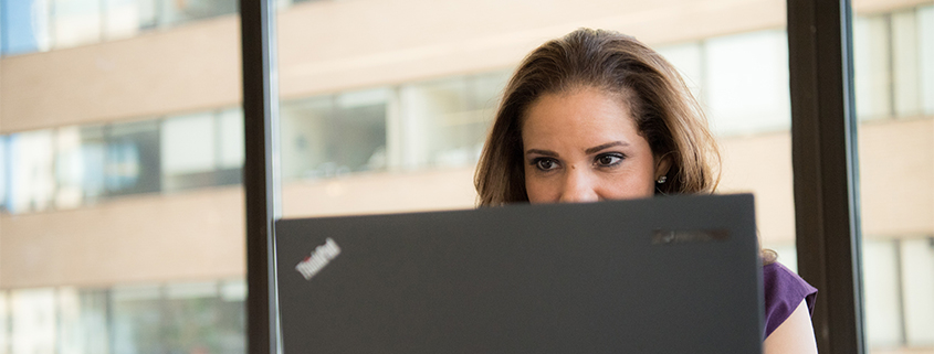 Woman looking at computer at work