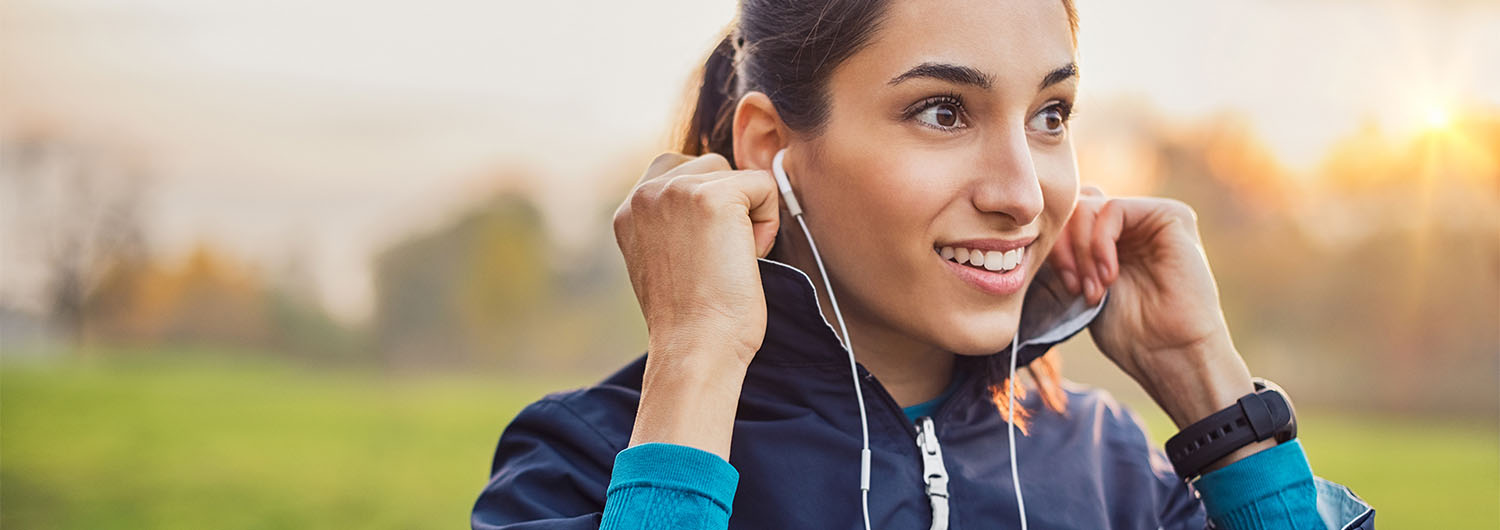 Athletic woman listening music