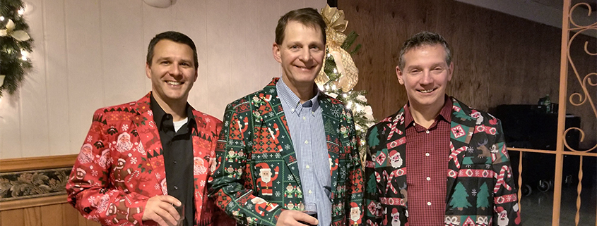 Dr. Salm, Dr. Vrabec, and Dr. Nowak wearing Christmas jackets